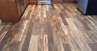 Laminate wood flooring in kitchen- light, medium and dark wood    Gainey Floorin...