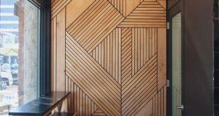 Holz umarmen: Intelligente Akustik und gemütliche Ästhetik prägen das Büro in Poznan