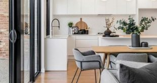 Love this open kitchen! Beautiful black and white decor with wood accents! @jess